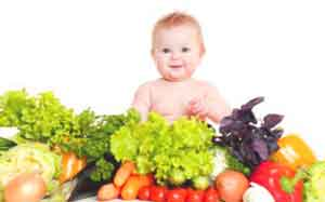 baby sitting by vegetables